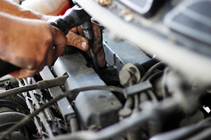 Hand of auto mechanic with a wrench